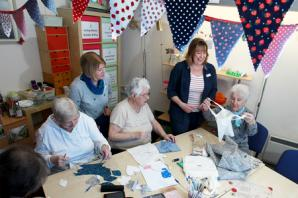 Visitors try their hand at patchwork for craft sessions at therapy centre